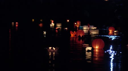 haft : Festival of lanterns on the water. Water lantern in the shape of a Lotus with a candle flame floating at night on the water.