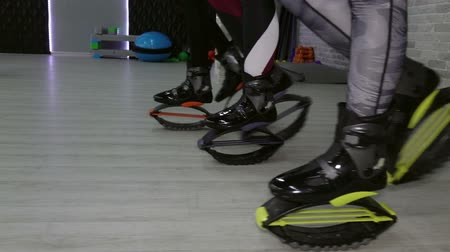 Closeup of sporty girl Kangoo jumps. Sports shoes.