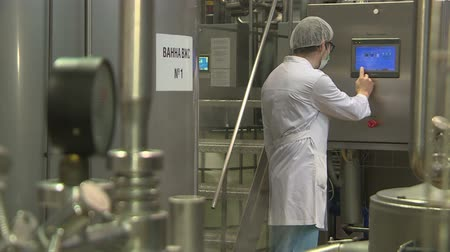 male-production engineer at the dairy plant . the concept of production, industry and people . Stock Footage