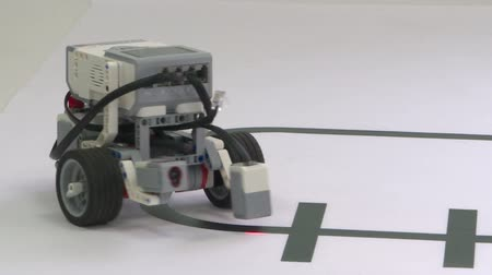 A robot with three wheels rides on a white table.Smart robot Stock Footage