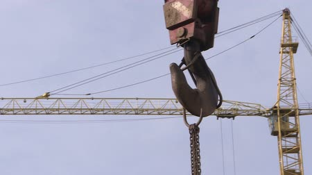 emel : The hook of a construction crane. Equipment on the construction site.
