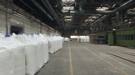 none : Bags of fertilizer in industrial production .