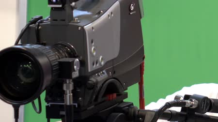 camera move : Operator with a professional video camera in a television Studio.