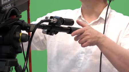filmmaker : Operator with a professional video camera in a television Studio.