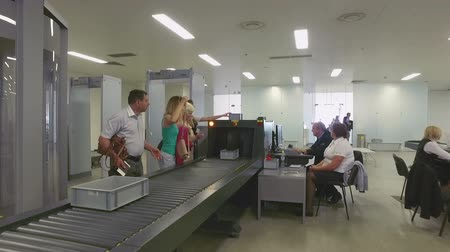безопасность : camera moves through the airport security control