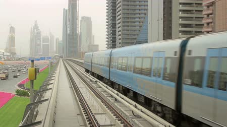 modern train wagon : subway train leaves from the camera in Dubai