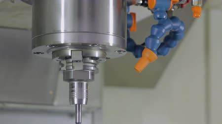 automatický : man pulls a cartridge from a drill machine industry