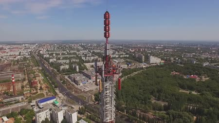 genişbant : servicemen work on a top of a Telecommunication Tower