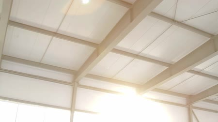 self storage : panorama of warehouse ceiling, sun shines to camera