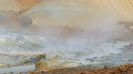 seltun : close up shot of stream with hot water between colored ground in geothermal area Seltun, Krysuvik Stock Footage