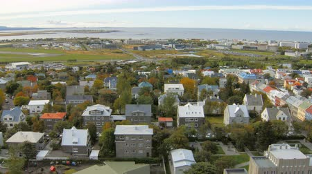 hallgrimskirkja : panorama of Reykjavik city from top in autumn time, view on roofs, local airport, Atlantic ocean Stock Footage