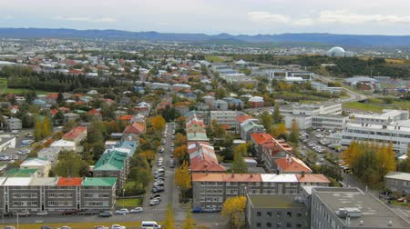 hallgrimskirkja : panorama of Reykjavik city from top in autumn time, view on multi colored roofs Stock Footage