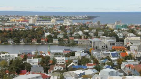 hallgrimskirkja : top view on panorama of Reykjavik city, lake Tjornin and Seltjarnarnes peninsula in autumn time Stock Footage