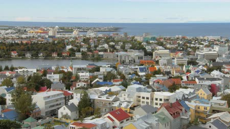 hallgrimskirkja : top view on panorama of Reykjavik city, lake Tjornin and Atlantic ocean on background Stock Footage