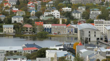 hallgrimskirkja : top view of Reykjavik city with lake Tjornin in autumn time, calm cityscape, colored living houses