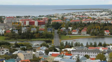 hallgrimskirkja : top panorama of Reykjavik city with lake Tjornin in autumn time, calm cityscape