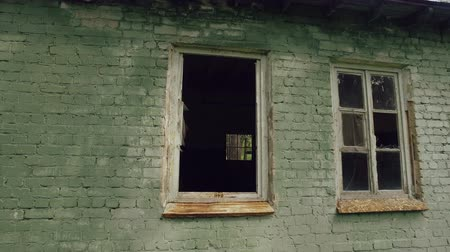 elhagyatott : view from old broken window to dark scary room, small window with lattice in center of frame