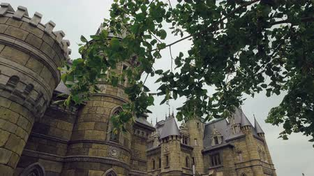 rycerze : amazing medieval castle in summer day, camera moves forward through branches of trees