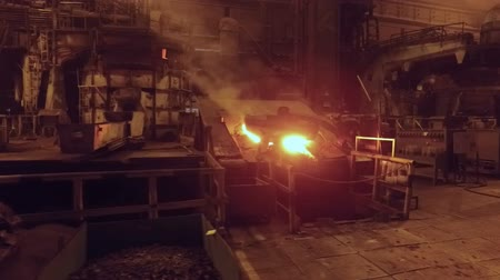 metallurgical plant : moving shot in foundry in metallurgical plant, open fire and red-hot metal in blast furnace