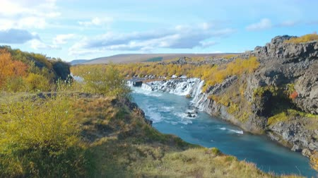 hraunfossar : moving shot of Hraunfossar waterfall in western of Iceland in autumn sunny day