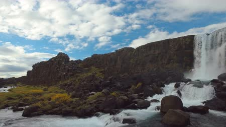 southwest iceland : small amazing waterfall Oxararfoss and river in Iceland at tectonic plate fracture in autumn Stock Footage