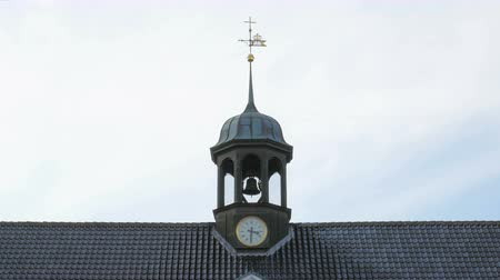 мифический : close up shot of bell tower of old danish church in centre of Copenhagen