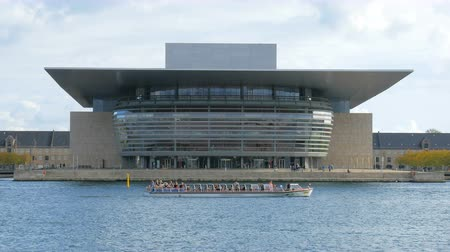 copenhagen : touristic boat is floating near Copenhagen Opera House in sunny day