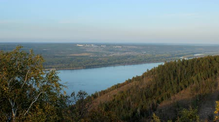 volga region : top view of wide river and small city near in sunny summer day, slopes of hills Stock Footage