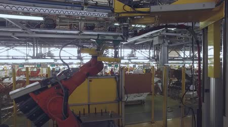 üveges : robot is giving a rear window of automobile for sealing machine in a car plant