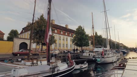 copenhagen : Copenhagen, Denmark - OCT, 2016: many of sailboats is moored in a water canal, moving shot along embankment and living houses, view from water Stock Footage