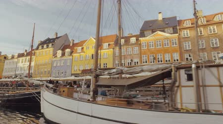 copenhagen : Copenhagen, Denmark - OCT, 2016:panorama of buildings and yachts in Nyhavn, New Harbour in evening, view from boat, in movement Stock Footage