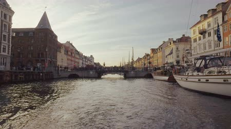 copenhagen : Copenhagen, Denmark - OCT, 2016: rear view of the stern of floating boat in Nyhavn, New Harbour in evening Stock Footage