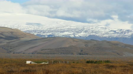 islandia : huge tongue of icelandic glacier, covered old ice and ashes, view in sunny fall weather