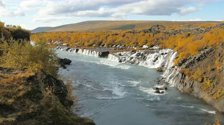 hraunfossar : valley with famous and picturesque waterfalls Hraunfossar in Iceland in sunny autumn weather Stock Footage