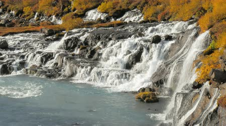 hraunfossar : Hraunfossar waterfalls are pouring into Icelandic Hvita river in sunny day in autumn