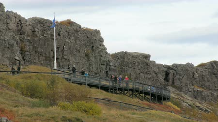 nordic countries : people are standing on a observation desk area near fault of tectonic plates in Iceland Stock Footage