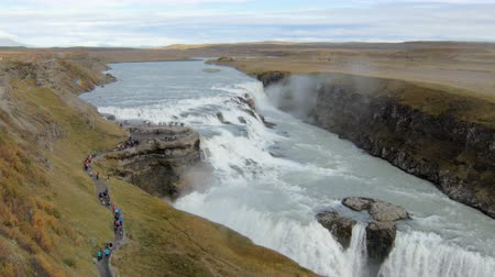 gullfoss : famous icelandic waterfall Gullfoss in cloudy fall day, many of tourists are walking on a path