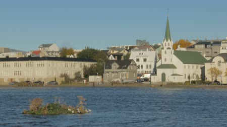 reykjavik : view of old traditional buildings near lake Tjornin in Reykjavik in sunny autumn day