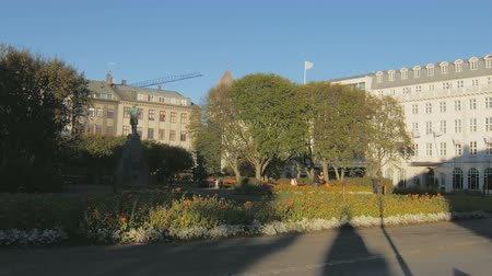 kurmak : Reykjavik, Iceland - SEP, 2016: square in from of building of parliament with flowerbeds, building
