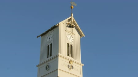 reykjavik : top of tower of icelandic church with clock, bells and weathercock, against clear blue sky Stock Footage