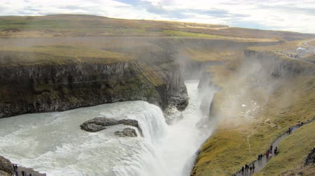 gullfoss : epic view on icelandic waterfall Gullfoss and Hvita river valley at the bottom, tourists are walking