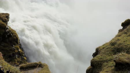 outstanding : rapid flow of powerful waterfall between two rocks covered moss, epic view Stock Footage