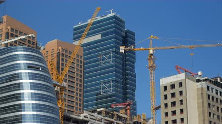 construction crane : modern skyscrapers and unfinished building in a downtown in summer Stock Footage