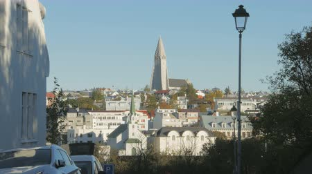 hallgrimskirkja : Reykjavik, Iceland - SEP, 2016: view on a city buildings with famous Hallgrimskirkja in sunny weather Stock Footage
