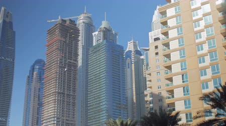 cayan tower : DUBAI, U.A.E. - JAN, 2018: panorama of living houses and high office center in Dubai Marina area