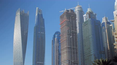 cayan tower : DUBAI, U.A.E. - JAN, 2018: view on skyscrapers and buildings in Dubai Marina area