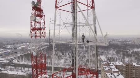 truss : aerial shot of a television tower in a winter cloudy daytime Stock Footage