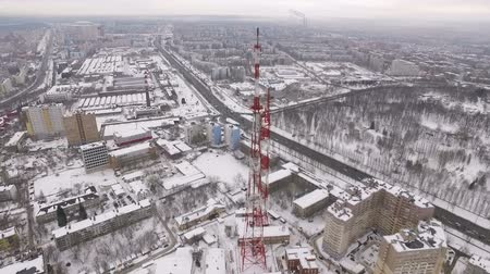 truss : aerial view on modern telecommunication tower, of modern industrial city in winter