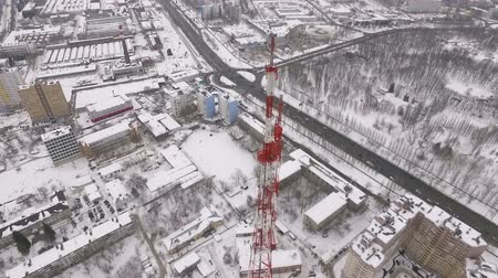 microonda : amazing drone flight over a modern telecommunication tower, buildings and roads