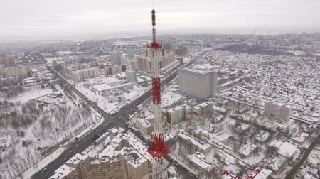 microonda : aerial view on top of telecommunication tower and urban landscape with park and crossroads Stock Footage